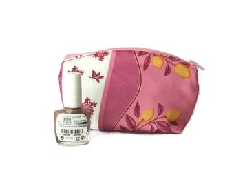 Small cosmetic case in pink fabric