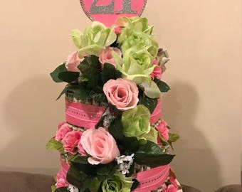 Cake Made of Money Flowers and Ribbons