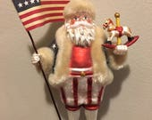 Blown Glass Santa with Rocking Horse and American Flag