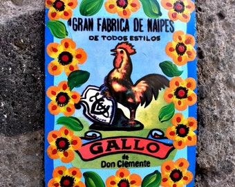 Rooster traditional Mexican painting on metal ex voto style with yellow flowers