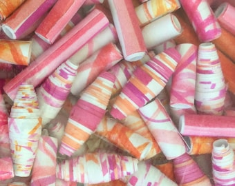 Bag of pink, orange and white hand-made paper beads
