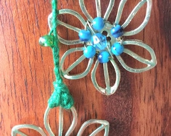 Green adjustable necklace/bracelet crochet w/beads adorned with blue/green/silver flowers