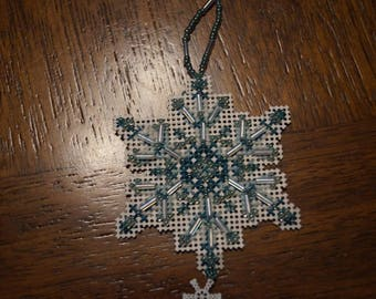 teal and white handmade beaded snowflake
