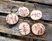 Pyrography Art Nature themed keychains, wood burned designs, live edge birch slices, Mountains, Eagles, Birch trees, Birds or Rushes, nature