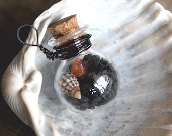 Nature tiny glass vial necklace with black salt, carnelian crystal and tiny seashell.