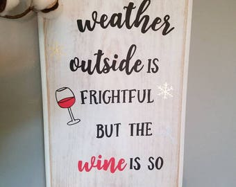 The weather outside is frightful, but the wine is so delightful wall decor sign