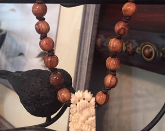 Vintage Carved Bone Pendant and Jerusalem Olive Wood Beaded Necklace on Knotted Leather and Antique Brass Chain with Toggle