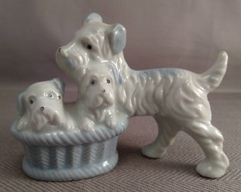 White and Blue Glazed Ceramic Terrier With Pups in a Basket