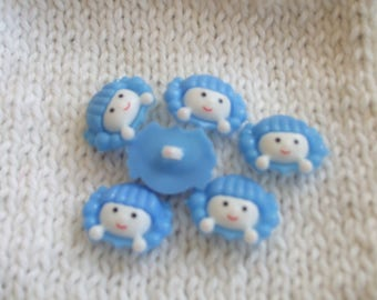set of little girl blue and white head buttons