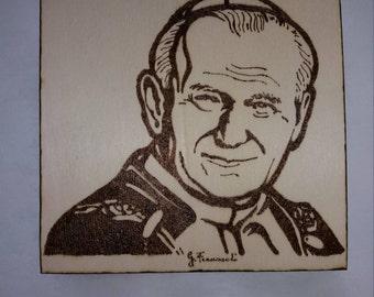 Burning painting by hand. Saint John Paul II.