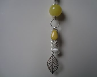 Necklace with drop shape sequin, bead and charm