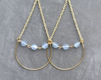Keliani earrings // blue beads suspended between chain and wire