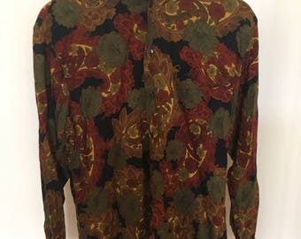 dark patterned 70s style long sleeved button up shirt