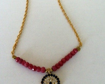 Ruby and gold plated necklace