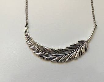 Chain and large antique silver feather necklace