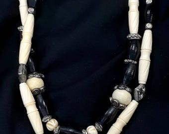 double strand carved bone turtle pendant