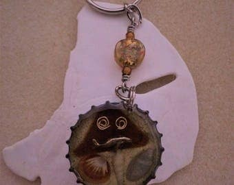 Beer bottle cap key chain with whale and beach glass
