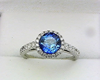 AAAA Blue Sapphire  7.00 mm  1.41 Carats   Manmade Sapphire 14K white gold Halo ring with .50 carats of diamonds MMM