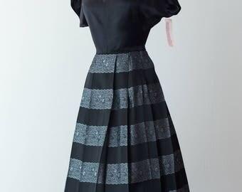 Vintage 1950s Dress - 50s Black Silk Cocktail Dress w/ Metallic Silver Brocade Pleated Skirt & Sweetheart Neckline // Waist 25
