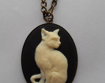 Ivory cat on black cameo pendant necklace. Kitty pendant. Cameo jewelry. Cat jewellery. Black necklace. Cat lover gift. Cat jewelry.