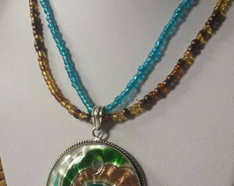 Amazing colorful detronic glass swirling with golden copper and turquoise colors