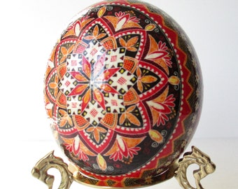 Ostrich egg Pysanka by Katya Trischuk in traditional Ukrainian pattern with Red and Orange