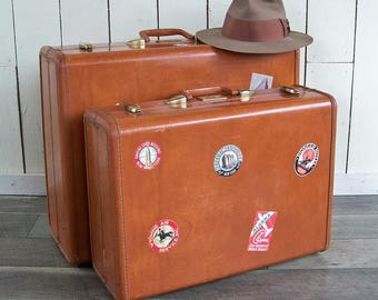 A Pair of 1950s Camel Brown Samsonite Suitcases with Travel Stickers - Samsonite Streamlite Luggage