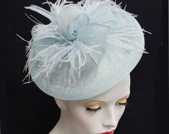 Pale blue powder blue saucer tilt sinamay fascinator hatinator hat with feather detail - headband fixing