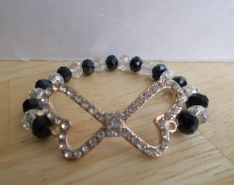 SALE Gold and Clear Rhinestone Bow Charm Stretch Bracelet with Clear and Black Crystal Beads