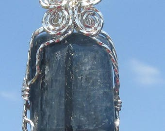 Polished Kyanite , wire wrapped Pendant in Argentium silver wire.