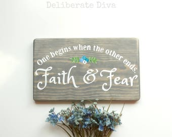 """Faith and Fear motivational sign in solid wood gray stained measuring 12""""x7"""" with white lettering"""