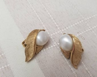 Lovely Trifari clip on earrings with gold tone metal and faux pearl