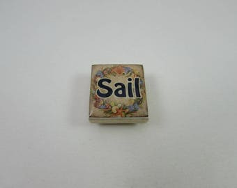 Fish Needle Minder from Designs by Lisa, made from upcycled scrabble tiles. Useful needlework accessory and makes a great gift too!