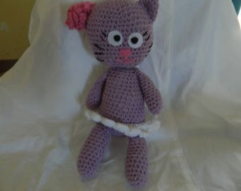 a purple and pink cat