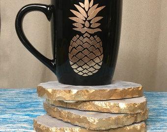 Gold pineapple on black mug