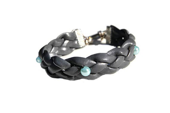 Plaited bracelet for woman from dark gray recycled artificial leather with blue beads in Western country style
