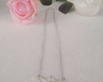 Silver chain and origami boat necklace
