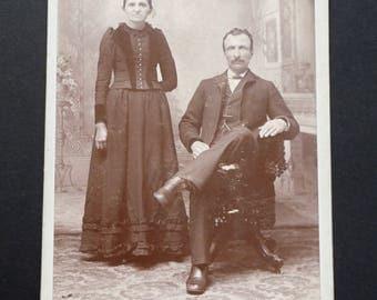 Business card. Photography 1900.sepia.homme moustache couple sitting. Victorian woman debout.J.A Dansereau.Woonsocket.Rhode Island.epoque.
