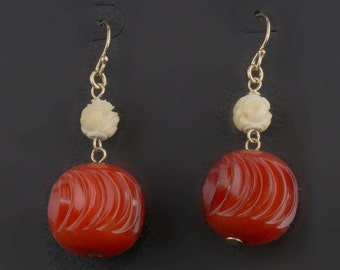 Earrings of vintage carved Galalith and bone beads. ervn950(e)