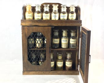 Spice Rack Jars John Wagner and Sons USA Apothecary Jars Herbs Original Labels Front and Back Wood Wooden Rack with Doors Farmhouse Kitchen