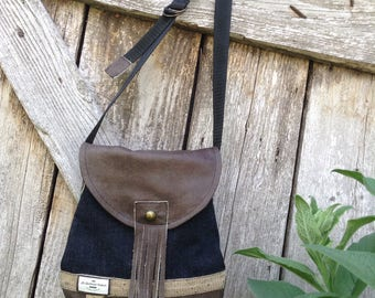 Small denim and leather bag