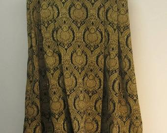 """Unique !!  Black w/gold metallic designs pleated skirt w/black trim at bottom of full skirt.....Med? 30"""" waist......."""