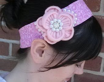 pink felt flower headband with white beading on a pink headband