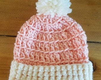 Pink and cream crochet newborn beanie with pom pom.