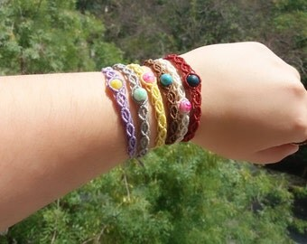 Macrame bracelet with glass or polymer clay beads