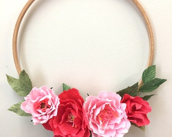 Wooden wreath decorated with crepe paper flowers, handcrafted with floral Italian paper