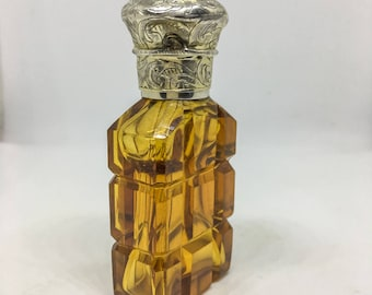 Victorian perfume bottle in amber glass with silver cap.
