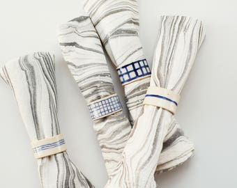 set of 4 modern ceramic napkin rings / blue and white / line and grid pattern