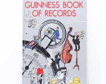 guinness book of records | 1975 edition | edition 22 | vintage illustrations book | history collectors book | coffee table books