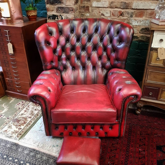 VINTAGE CHESTERFIELD : Red leather monksback chair.